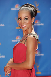 TV personality Shaun Robinson, showed off a braided bun while walking the red carpet at the Emmy Awards.