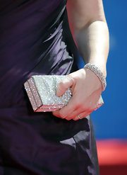 Jane paired her purple dress with a stunning crystal embellished box clutch.