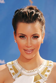 Kim Kardashian showed off her textured loose bun while hitting the Emmy Awards red carpet.