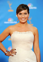Mariska paired her sleek bun with ruby and diamond pendant 18-karat yellow gold ball earrings.