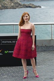 Jessica Chastain enchanted in a red jacquard fit-and-flare cocktail dress by Dsquared2 during the 'Eleanor Rigby' photocall.
