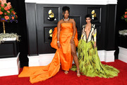 Doja Cat flaunted major skin at the 2021 Grammys in a Roberto Cavalli by Fausto Puglisi gown that featured a neckline that dipped below the navel!