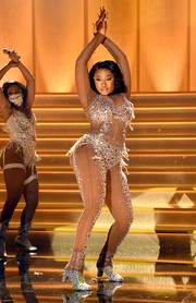 Megan Thee Stallion worked a Swarovski crystal-embellished illusion bodysuit by Dolce & Gabbana for her performance at the 2021 Grammys.