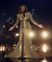 Mickey Guyton glammed up in a gold sequined gown by Naeem Khan for her performance at the 2021 Grammys.