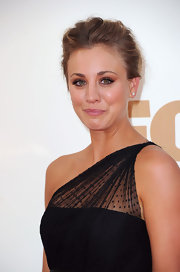 For an elegantly youthful look, Kaley Cuoco wore her hair in a slightly mussed updo.