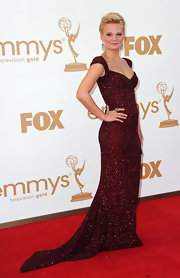 Martha Plimpton sparkled at the 2011 Emmys in a burgundy beaded dress, complete with cap sleeves and a subtle train.
