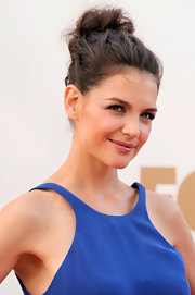Katie Holmes chose an ultra casual 'do for the 63rd Emmys. To try her look at home, collect hair loosely into a high pony tail, twist and secure with bobby pins. It's so simple and sweet.