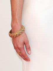 Aubrey Plaza added some glitter to her look with a stunning gold and diamond bangle when she attended the Emmy Awards.