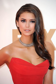Nina Dobrev's smoky eyes added to her sexy, sultry look at the 63rd Emmys. Black eye pencil was applied to inner rims and lash lines and a rich, bronzy shade of shadow was swept on upper lids and blended into creases. Nina's look was completed with false lashes and lots of volumizing mascara.
