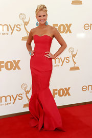 Nancy O'Dell was radiant on the 2011 Emmys red carpet in a scarlet strapless gown with a fluted mermaid skirt. She teamed her dress with striking turquoise jewels.