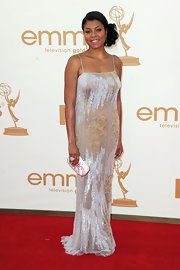 Taraji shined on the red carpet in a shimmering silver gown with delicate spaghetti straps. She finished off the look with a side swept updo.