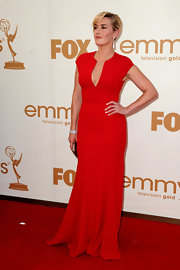 Kate Winslet was o trend at the 2011 Emmys in a red gown. The sexy neckline and simple silhouette worked perfectly with Kate's curves.