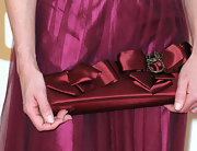 Elizabeth McGovern accessorized with a bow-embellished burgundy satin clutch at the Emmy Awards.