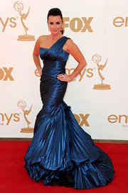 Kyle Richards dazzled on the red carpet in a metallic blue one-shoulder gown. The gown featured a draped bodice and an accordion pleat train.