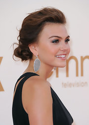 Aimee Teegarden complemented her simple, black gown and silver statement earrings with an elegant windswept updo. To try her look, add a little backcombing, then pull hair back and secure in a low ponytail. To finish, take portions of ponytail, loosely twist and pin into place.