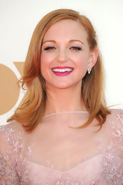 Jayma Mays added a pop of bold fuschia to her lips for the 63rd Emmys. The vibrant color created a striking contrast to her demure, mauve dress and sweetly styled locks.