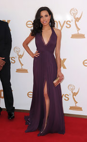 Jurnee shined at the Oscars in a deep purple halter gown with a plunging neckline and accordion pleated detailing. The thigh-high split showed off her toned legs.