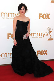 Michelle Forbes added sparkle to her black ruffle gown with a silver crystal mesh vintage clutch.