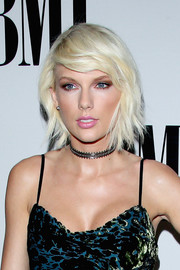 Taylor Swift kept her look on trend with a Noudar black diamond choker necklace at the BMI Pop Awards.