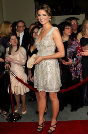 Stana accessorized her chic beaded frock with platform strappy sandals.