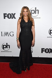 Patricia Southall cut a shapely silhouette in her black lace-panel mermaid gown during the Miss Universe Pageant.