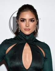 Olivia Culpo achieved super-sexy eyes with a heavy application of dark brown shadow.
