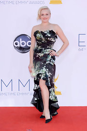 Elisabeth Moss showed some leg in her floral fishtail gown at the Emmy Awards.