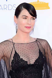 Lena Headey kept her accessories simple at the Emmy Awards, wearing only a pair of silver leaf earrings.