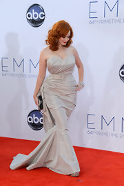 Christina Hendricks looked devastatingly fabulous in her curve-hugging belted gray gown.