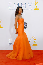 Padma Lakshmi was a vision in this hot orange tulle gown at the Emmy Awards.