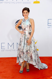 Ariel Winter paired her pastel-printed asymmetrical gown with statement-making silver platform pumps.