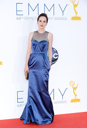 Michelle Dockery went for a demure route in a shiny blue gown at the Emmy Awards.