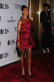 Jada paired her ruffled dress with an invisibly set ruby and diamond leaf brooch, which she wore on her wrist.