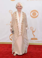 Ellen adorned herself in a nude gown, cloaked beneath a sheer cover in a geometric pattern.