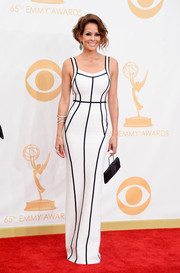 Brooke showed off her beautiful figure in a white bandage dress with black piping accents.