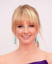 Melissa chose to accessorize with pops of turquoise that dangled beneath her elegantly styled tresses.