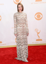 Kristen shimmered in chevrons in this silver, long-sleeve gown with slightly flared skirt and sleeves.