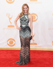 Leslie stepped onto the carpet in a fitted, chevron peek-a-boo gown with micro-bead detailing.
