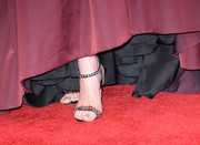 Michelle stepped onto the red carpet in black satin heels with red jewels embellished across the toe straps.