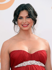 Morena Baccarin pulled back her chocolate waves into a face-framing updo for the red carpet of the 2013 Emmy Awards.