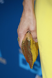 Lisa added extra bling with this gold-beaded envelope clutch.