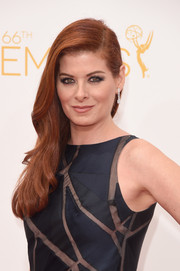 Debra Messing kept it classic and feminine with this gently wavy side sweep at the Emmys.