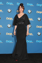 Katey Sagal went for ladylike elegance at the DGA Awards in a black Lorena Sarbu gown with a draped neckline, an embellished waistband, and flutter sleeves.