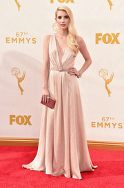 Emma Roberts was a vision on the Emmy Awards red carpet in a plunging champagne Jenny Packham  gown, which she matched with Queen Elsa-inspired platinum-blonde locks.