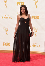 Taraji P. Henson exuded a sexy-edgy vibe at the Emmys in this black Alexander Wang gown featuring chain shoulder straps, a peekaboo bodice, and a sheer lace skirt.