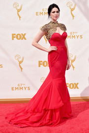 Laura Prepon wore a gorgeous red Christian Siriano mermaid gown with embroidered gold bolero-like detailing for her Emmy Awards look.