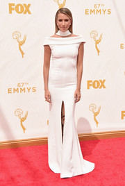 Renee Bargh walked the Emmys red carpet wearing a sleek white off-the-shoulder gown by Daniel Avakian.