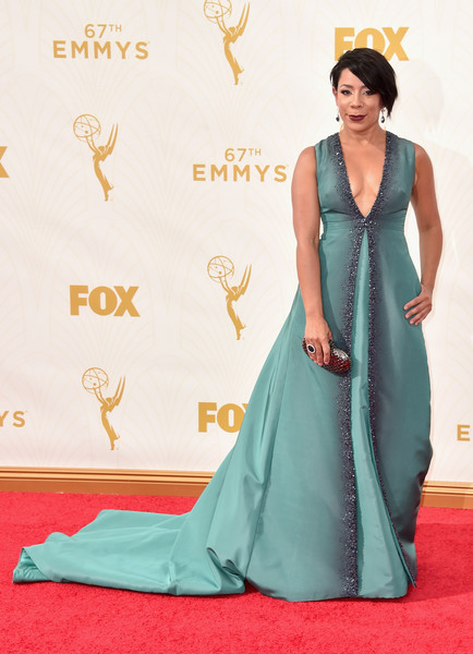 Selenis Leyva looked resplendent at the Emmys in an ombre teal Pamella Roland gown with gray beading cascading from the neckline to the hem.