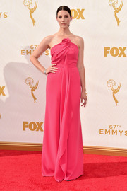 Jessica Pare oozed sweetness in a rosette-detailed hot-pink strapless gown by Monse at the Emmy Awards.