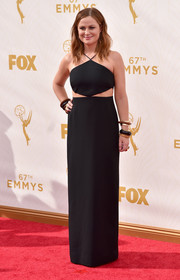 Amy Poehler went edgy-sexy at the Emmys in a black Michael Kors halter dress with waist cutouts.